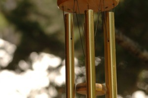 A hanging wind chime made from metal bars.