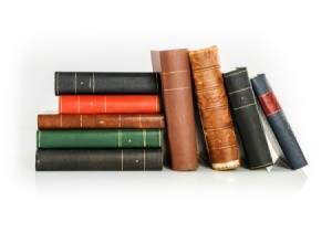 A bunch of antique looking hardcover books.