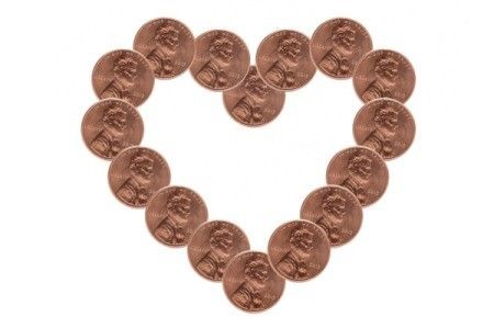 A heart made out of pennies on a white background.
