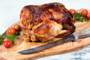 A rotisserie chicken, ready for carving.