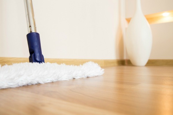 A Hardwood Floor With Mop Ready To Clean