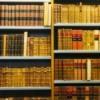 Bookshelves full of old encyclopedias.