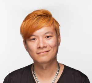A young man with orange hair.