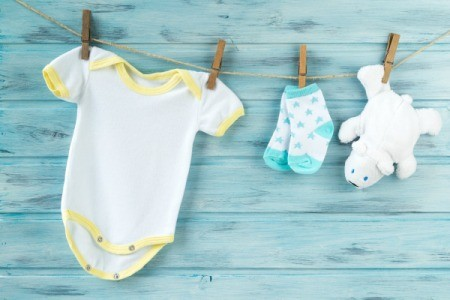 Baby clothes hanging up.