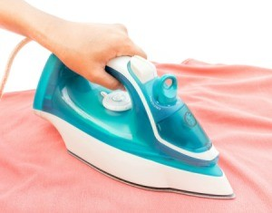 Ironing on an ironing board.
