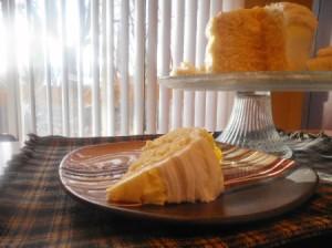 Lemon Vanilla Layer Cake with cut piece