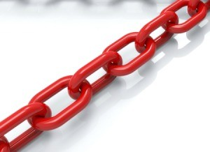 Chain that is painted red to help prevent rust.