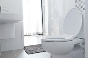 A clean white toilet in a home.