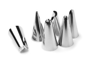 Metal cake decorating tips in several different shapes.