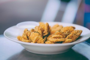A plate of deep fried dill pickle chips.
