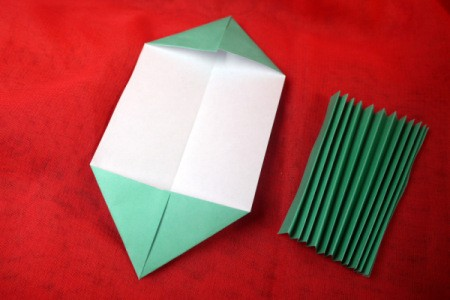 Pleated Paper Butterfly - fold four corners to the center on wrong side of paper
