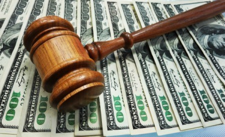 A gavel and money.
