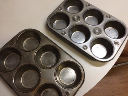 2 muffin tins on table