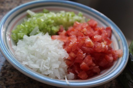diced onion, tomato and celery in a bowl