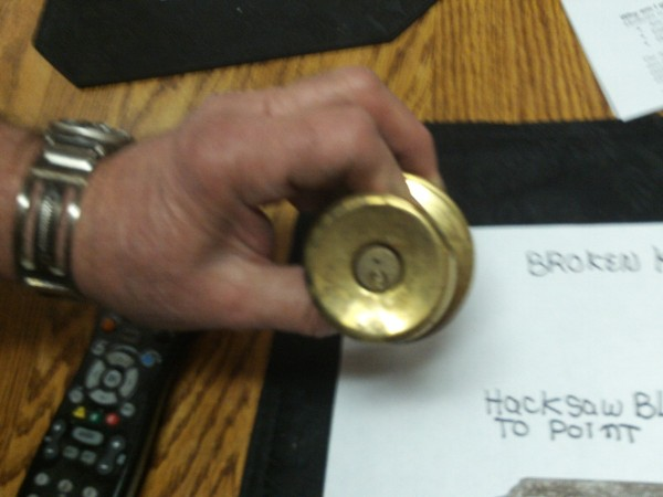 A doorknob lock with a broken key.