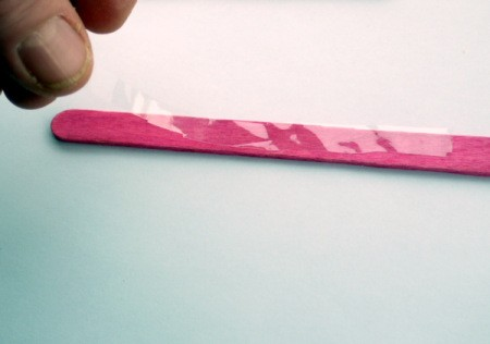 Popsicle Stick Toy Harmonica - lay cellophane on one of the sticks