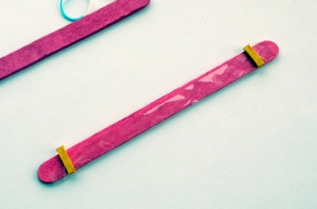 Popsicle Stick Toy Harmonica - place a piece of the splintered stick tip on each end of the stick on top of cellophane
