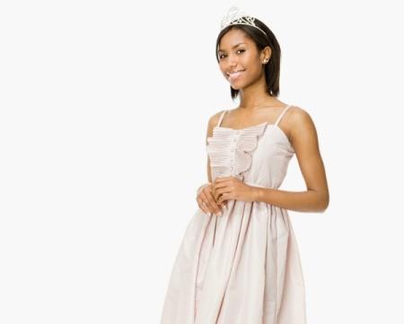 A high school girl wearing a nice prom dress.
