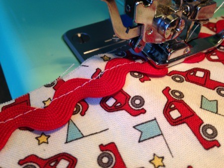 Whole Cloth Tied Quilt with Ric Rac Trim - sewing ric rac in place