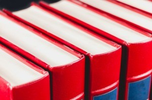 A line of red encyclopedias.