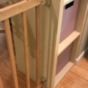 Installing a Baby Gate for a Wide Archway - attach gate hardware to wall and shelf
