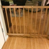 Installing a Baby Gate for a Wide Archway - gate between wall and shelf