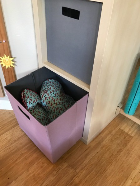 Installing a Baby Gate for a Wide Archway - blanket filled fabric baskets in shelf assembly