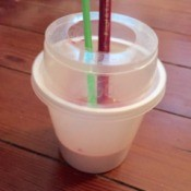 Use a Yogurt Cup for Paint Water - two brushes in cup of water