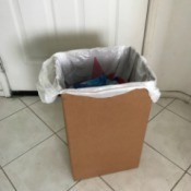 Recycled Boxes as a Trash Can - plastic bag inside cardboard box being used as a trash can