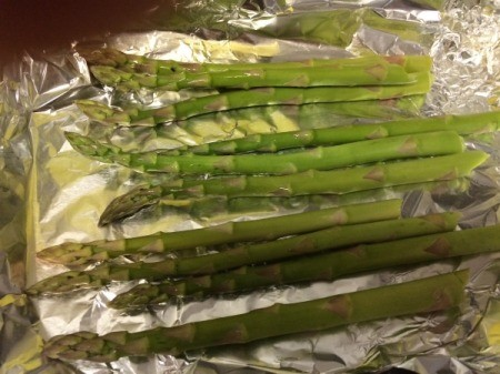 Asparagus laid out on foil