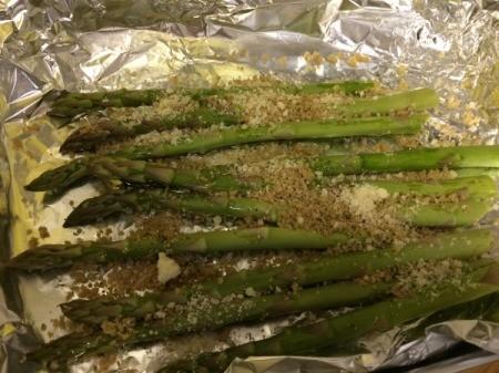 sprinkling parmesan on asparagus
