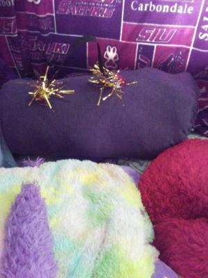 Bedroom Window Draft Blocker - purple stuff sack on bed