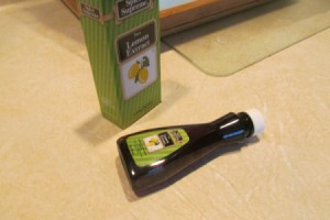 Lemon Extract for a Clean  Smelling Kitchen - bottle of lemon extract lying on its side on countertop