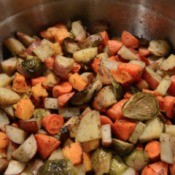 Herb Roasted Brussels Sprouts, Sweet Potatoes and Carrots in bowl