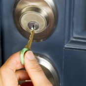 A key being placed into a front door lock.