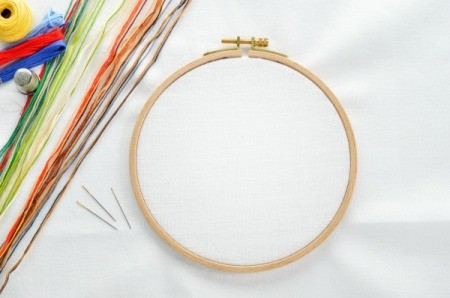 An embroidery hoop set up and ready for a cross stitch project.