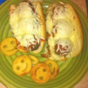 Meatball Subs and happy face fries on plate