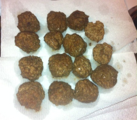 draining cooked meatballs