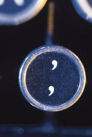 An apostrophe and comma key on an old typewriter.