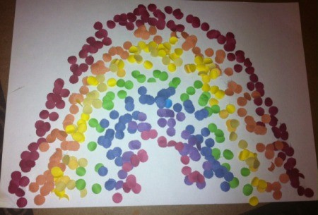 Hole-Punch St. Patrick's Day Art - use glue stick and punches to create your rainbow