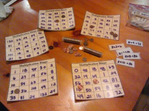 Homemade Math Bingo Game - bingo cards and rolls of pennies