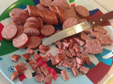 diced sausage and knife on plate
