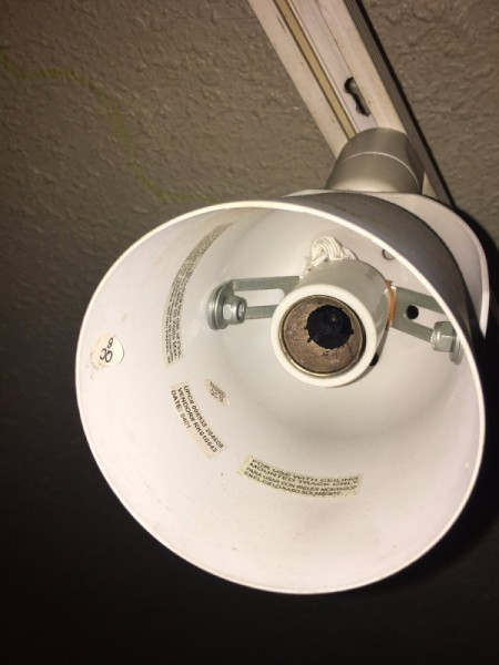 A light fixture with no lightbulb attached.