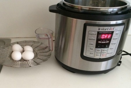 A pressure cooker being used to make hard boiled eggs.