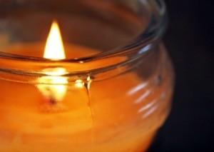 A lit jar candle.
