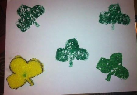 St. Patrick's Day Sponge Paintings - pour green paint onto a plate and print shamrocks
