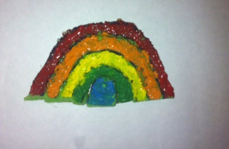 St. Patrick's Day Sponge Paintings - use paint brushes to add paint to each section of the rainbow