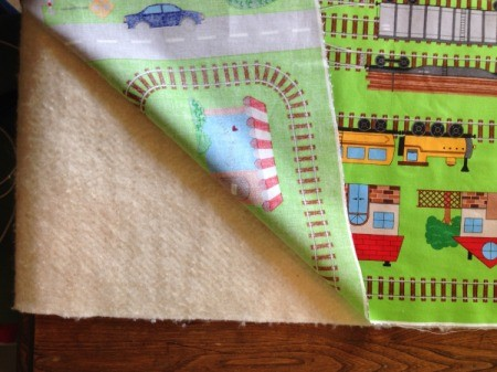Fabric Panel Playmat - place one panel over the batting