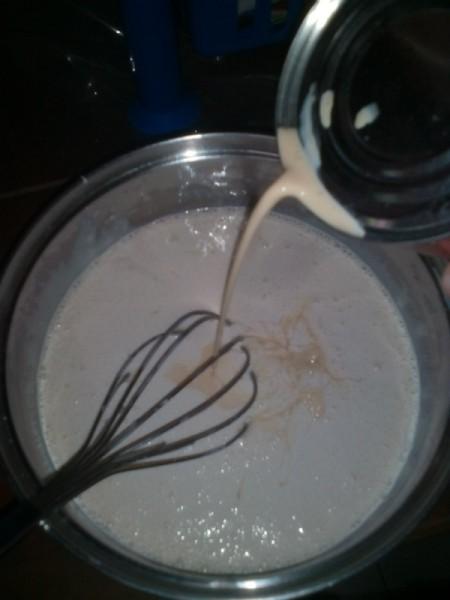 adding evaporated milk to bowl