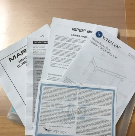 A bunch of warranty documents on a clear case.